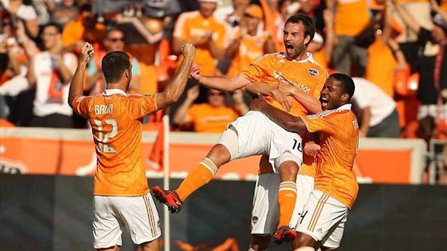 Adam Moffat celebrates his goal against Sporting Kansas City with Houston Dynamo team-mates Will Bruin and Bobby Boswell (AFP)