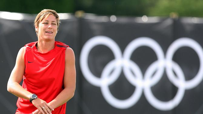 FILE - In this Aug. 2, 2012 file photo, United States' Abby Wambach trains during soccer practice for the 2012 London Summer Olympics at Cochrane Park in Newcastle, England. Wambach and Alex Morgan are to headline the National Women's Soccer League, the third incarnation of a women's professional soccer league in the United States. The season kicks off Saturday, April 13, 2013, with FC Kansas City hosting Morgan and the Portland Thorns FC in Kansas. Wambach, who will play for the Western Flash in her hometown of Rochester, N.Y., will travel Sunday to face Sky Blue FC in Piscataway, N.J. (AP Photo/Scott Heppell, file)