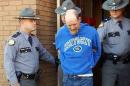 In this image taken from video, Kentucky State Police escort Timothy Madden from State Police Post 3, Friday, Nov. 20, 2015, in Bowling Green, Ky. Madden was arrested Friday and charged with murder and sex crimes in the death of Gabriella Doolin, a 7-year-old Kentucky girl whose body was found in a creek minutes after she disappeared during a football game Saturday night, Nov. 14. (Sky Walker/WKRN via AP) TELEVISION OUT