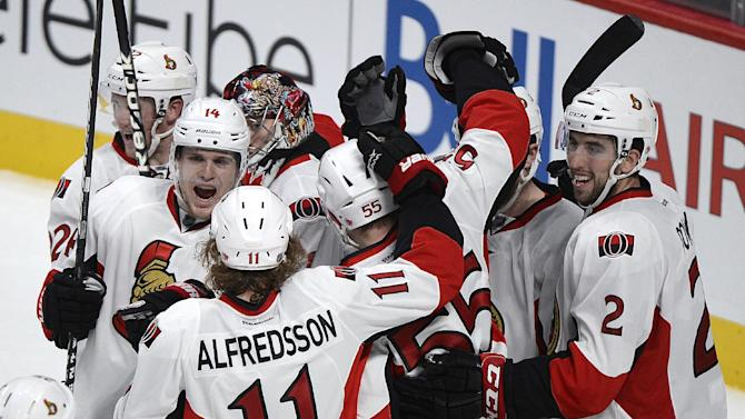 Players from the Ottawa Senators celebrate after defeating the Montreal Canadiens in Game 5 first-round NHL hockey Stanley Cup playoff series in Montreal, Thursday, May 9, 2013. Ottawa took the best-of-seven series 4-1. (AP Photo/The Canadian Press, Graham Hughes)