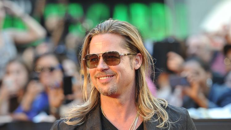"Actor Brad Pitt attends the premiere of ""World War Z"" in Times Square on Monday, June 17, 2013, in New York. (Photo by Evan Agostini/Invision/AP)"