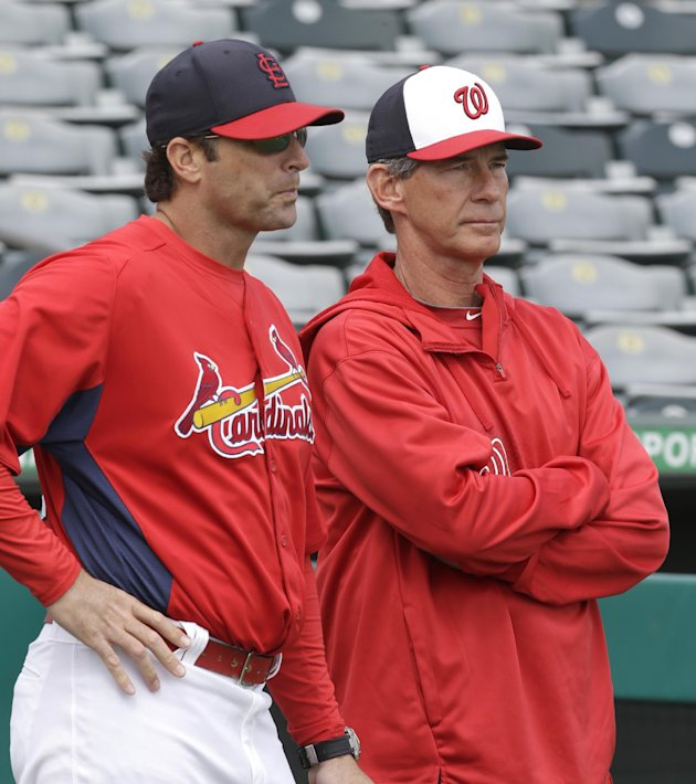St. Louis Cardinals manager Mike Matheny, left, talks to Washington Nationals bullpen coach Jim Lett  before an exhibition spring training baseball game, Saturday, March 2, 2013, in Jupiter, Fla. (AP