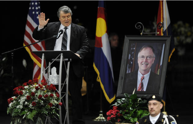 George Lombardi, left, leads other corrections official in swearing an oath to follow the ideas of Tom Clements during a public memorial for the chief executive of the Colorado Department of Correctio