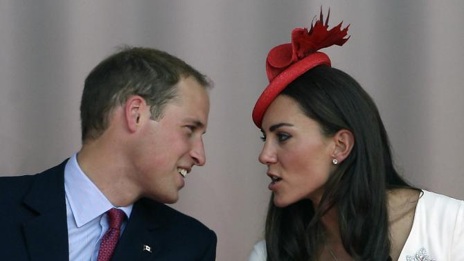 Prince William and Kate, the Duke and Duchess of Cambridge talk during a Canada Day celebration on Parliament Hill in Ottawa, Canada, as part of their Royal Tour of Canada Friday, July 1, 2011. (AP Photo/Charlie Riedel)