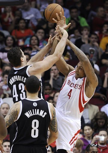 Harden, Asik lead Rockets past Nets