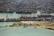 Work on a new jetty in the port of Colombo on July 19. Sri Lanka said Thursday its $1 billion 10-year bond issue was oversubscribed more than seven times, led by European and US investors, amid growing confidence in the island after a long civil war