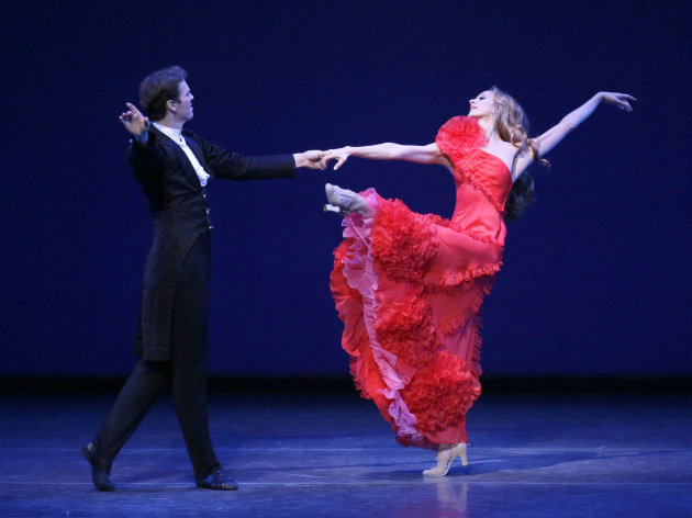 This Thursday, Sept. 20, 2012 image released by the New York City Ballet shows Maria Kowroski and Charles Askegard in &quot;Sophisticated Lady&quot; at the New York City Ballet fall gala, with costumes designed by Valentino Garavani in New York. (AP Photo/New York City Ballet, Paul Kolnik)