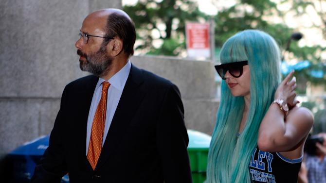 FILE - In a Tuesday, July 9, 2013 file photo, Amanda Bynes, accompanied by attorney Gerald Shargel, arrives for a court appearance in New York on allegations that she chucked a marijuana bong out the window of her 36th-floor Manhattan apartment. Bynes has been hospitalized for a mental health evaluation after deputies said she started a small fire in the driveway of a home in Southern California. Ventura County sheriff's Capt. Don Aguilar says deputies responding to a call Monday night, July 22, 2013 found Bynes standing next to the flames in the city of Thousand Oaks, Calif. The deputies determined she met the criteria for a mental health hold and took her into custody. She can be held for up to 72 hours of observation. (AP Photo/Bethan McKernan, File)
