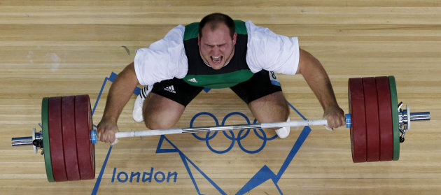 Peter Nagy of Hungary competes in the men's +105-kg, group B, weightlifting competition at the 2012 Summer Olympics, Tuesday, Aug. 7, 2012, in London. (AP Photo/Ng Han Guan)