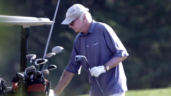 Actor Larry David returns a club to the cart while playing golf with President Barack Obama, not shown, at Farm Neck Golf Club in Oak Bluffs, Mass., on the island of Martha's Vineyard, Saturday, Aug. 17, 2013. (AP Photo/Steven Senne)