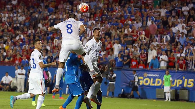 Clint Dempsey of USA connects with a high ball to score against Honduras during their 2015 CONCACAF Gold Cup Group A match at Toyota Stadium on July 7, 2015 in Frisco, Texas