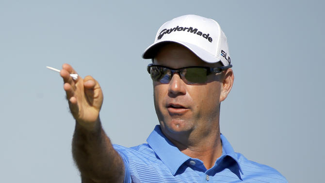 Stewart Cink plans his shot on the 16th hole during the third round of the McGladrey Classic golf tournament on Saturday, Oct. 25, 2014, in St. Simons Island, Ga. (AP Photo/Stephen B. Morton)