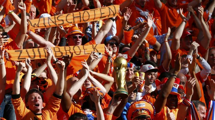 Netherlands fans cheer after they won the match during the 2014 World Cup Group B soccer match between Australia and Netherlands at the Beira Rio stadium