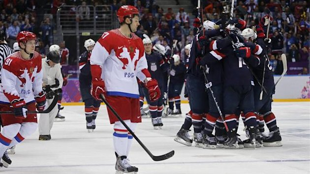 Team USA's T.J. Oshie (2nd R) celebrates with teammates next to Russia's Alexander Radulov (front) and Vladimir Tarasenko (extreme L), (Reuters)