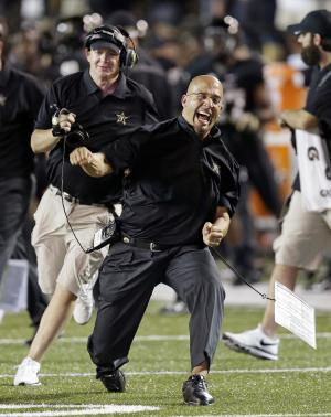 FILE - In this Aug. 30, 2013 file photo, Vanderbilt head coach James Franklin, center, celebrates after Vanderbilt took the lead against Mississippi during the fourth quarter of an NCAA college football game in Nashville, Tenn. Penn State has hired Franklin as its next head coach. Franklin, 41, who led Vanderbilt to bowls in all three of his seasons there, replaces Bill O'Brien, who left the Nittany Lions after two years to coach the NFL's Houston Texans. Penn State made the announcement Saturday, after the school's compensation committee met to finalize the contract. (AP Photo/Mark Humphrey, File)