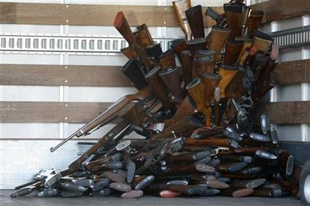 A small portion of guns that were turned in by their owners are stacked inside a truck at a gun buyback held by the Los Angeles Police Department in Los Angeles, California, December 26, 2012 REUTERS/David McNew