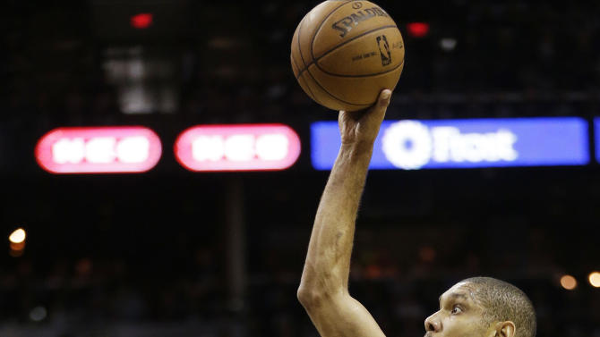 San Antonio Spurs' Tim Duncan (21) shoots over Miami Heat's LeBron James (6) during the first half at Game 5 of the NBA Finals basketball series, Sunday, June 16, 2013, in San Antonio. (AP Photo/Eric Gay)