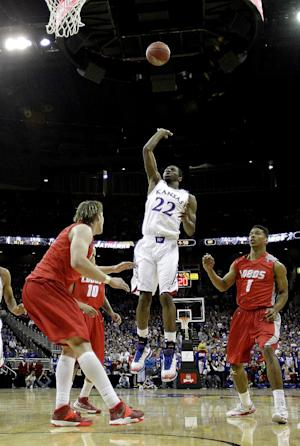 Ellis, Embiid lead No. 13 Kansas past New Mexico