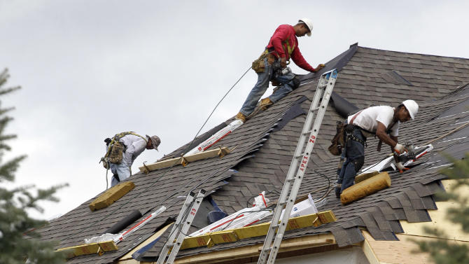 In this Friday, Oct. 12, 2012, photo, a construction workers finish a roof in Chicago. Confidence among U.S. homebuilders is at its highest level in six years this October, reflecting improved optimism over the strengthening housing market this year and a pickup in visits by prospective buyers to builders' communities.  (AP Photo/Nam Y. Huh)