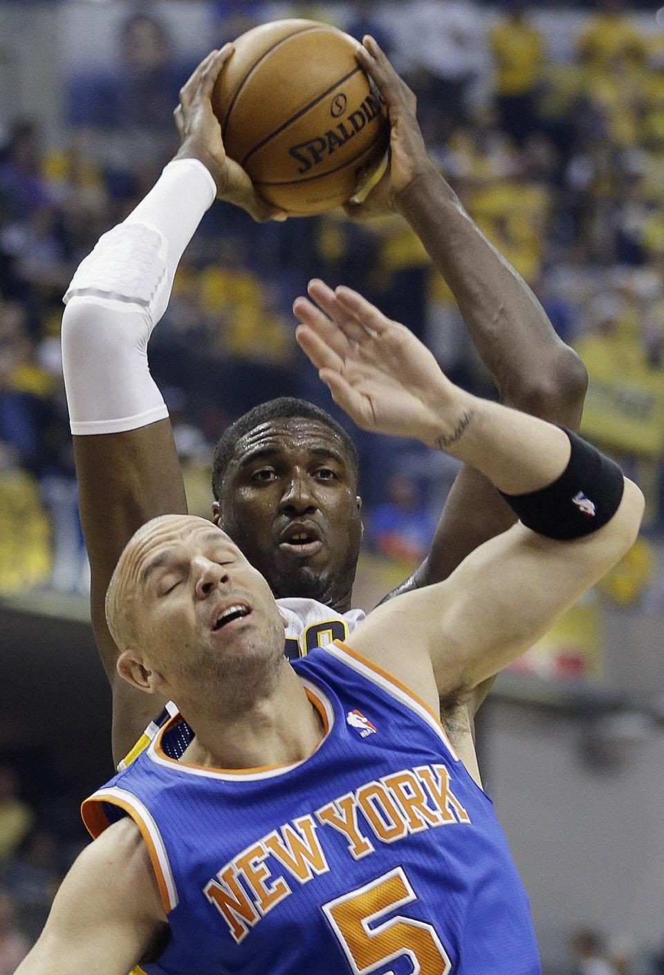 Indiana Pacers' Roy Hibbert grabs a rebound over New York Knicks' Jason Kidd (5) during the first half of Game 4 of an Eastern Conference semifinal NBA basketball playoff series on Tuesday, May 14, 2013, in Indianapolis. (AP Photo/Darron Cummings)