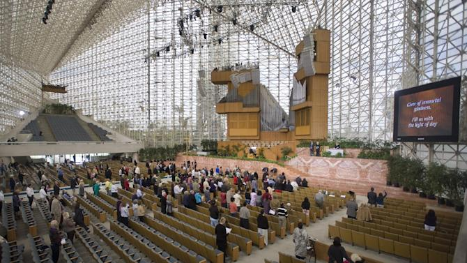 Attendees sparsely fill the seats at the Crystal Cathedral in Garden Grove, Calif., where it was announced Sunday, March 11, 2012, that the congregation will no longer be holding services at the current location. The church sold its iconic glass-paned cathedral to the Roman Catholic Diocese of Orange last month to emerge from federal bankruptcy protection. (AP Photo/The Orange County Register, Mindy Schauer)