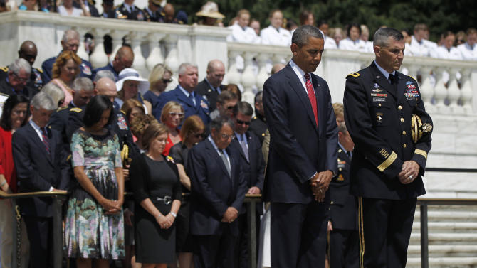 President Barack Obama, and Maj. Gen. Michael S. Linnington, Commander of the U.S. Army Military District of Washington, lowers their heads during a wreath-laying ceremony at the Tomb of the Unknowns at Arlington National Cemetery on Memorial Day, Monday, May 28, 2012, in Arlington, Va. (AP Photo/Pablo Martinez Monsivais)