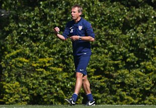 Jurgen Klinsmann wants the U.S. team to know it shouldn't be satisfied with making the knockout round. (Getty Images)