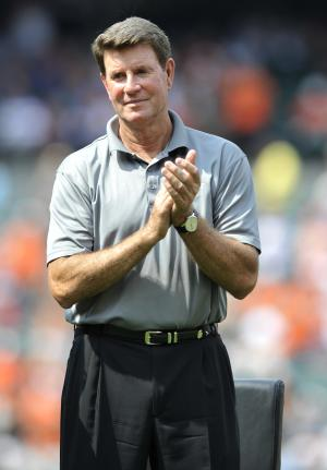 This photo taken June 30, 2012 shows former Baltimore Orioles Hall of Fame pitcher Jim Palmer clapping during a ceremony honoring former manager Earl Weaver  in Baltimore. Palmer is planning to auction off three Cy Young Awards and two Gold Gloves.(AP Photo/Gail Burton)