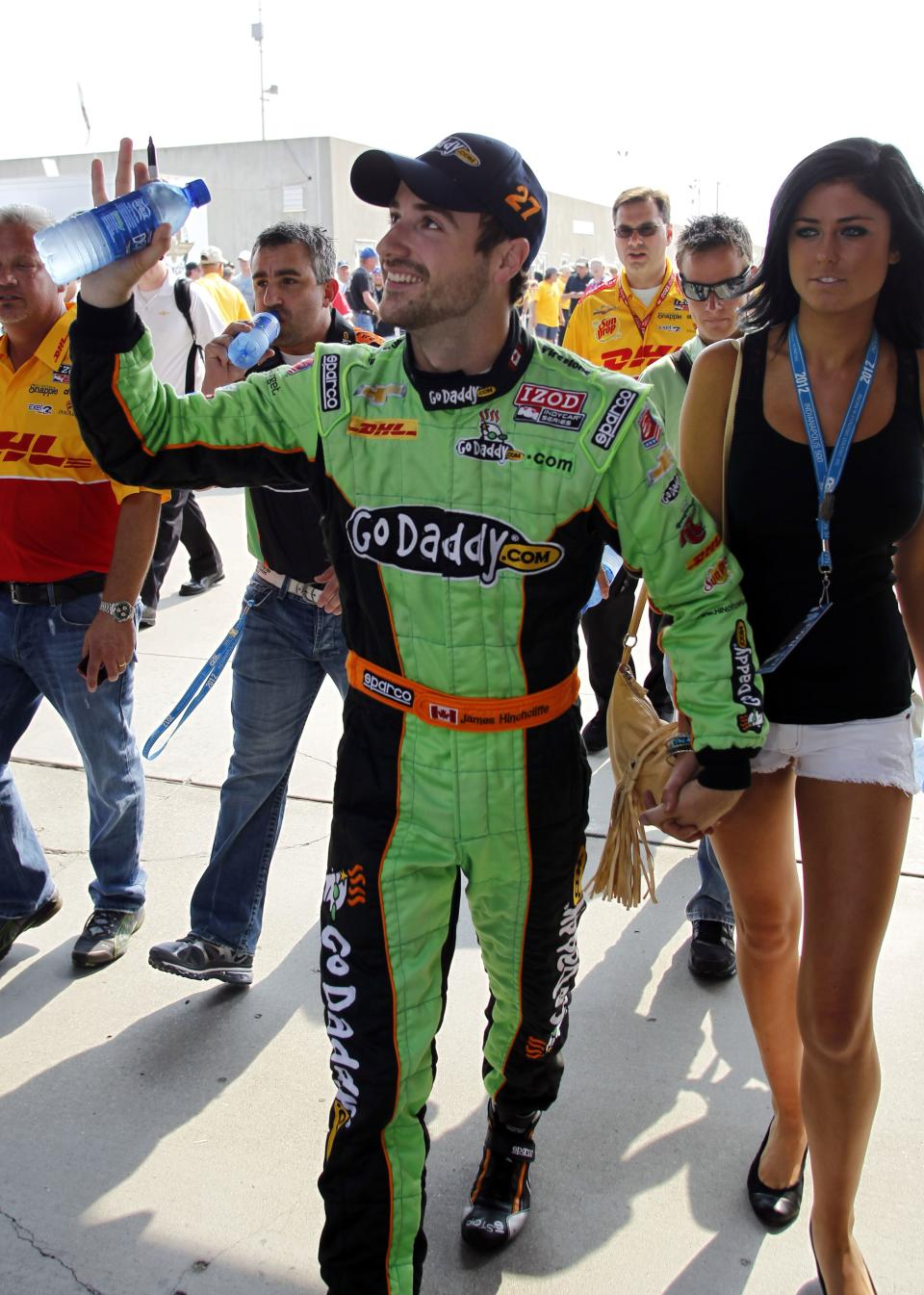 IndyCar driver James Hinchcliffe, of Canada, waves to fans as he walks to the pit area for the final day of practice for the Indianapolis 500 auto race at the Indianapolis Motor Speedway in Indianapolis, Friday, May 25, 2012. The 96th running of the race is Sunday. (AP Photo/Tom Strattman)