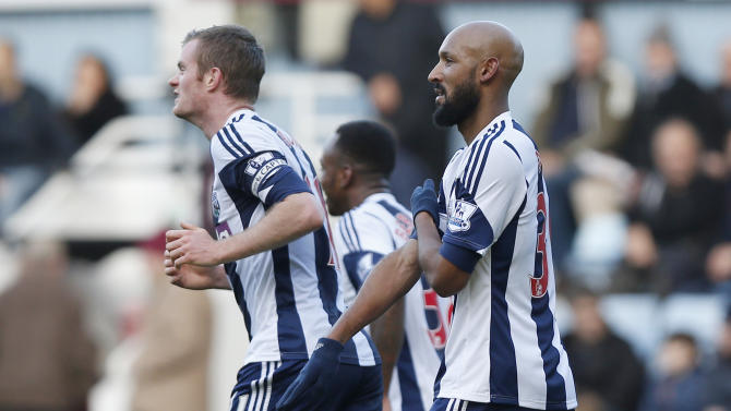 """FILE - This is a Saturday, Dec. 28, 2013. file photo of West Bromwich Albion's Nicolas Anelka, right, as he gestures to celebrates his goal against West Ham United during their English Premier League soccer match at Upton Park, London. It's caught on like a dance move one hand pointing downward, the other touching the shoulder with arm across the chest. But for many, the gesture is a hateful, anti-Semitic code. France's top security official wants the entertainer who popularized it banned from the stage. Dieudonne M'Bala M'Bala, who has performed for more than two decades and has a small but faithful following, contends the gesture, dubbed the quenelle, is no more than an anti-system sign, the equivalent of """"shove it."""" Soccer star Nicolas Anelka used it on Saturday Dec. 28to celebrate a goal, and basketball star Tony Parker did likewise. Both said they did not understand it was an anti-Semitic gesture. Parker said in his mea culpa contained in a statement released by the San Antonio Spurs that he """"thought it was part of a comedy act."""" (AP Photo/Sang Tan, File)"""
