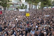 People in the Italian city of Brindisi take part in a demonstration against organised crime after a blast near a school in the city May 19. Police have arrested two suspects over the bombing that killed a 16-year-old girl and seriously injured five more teenagers