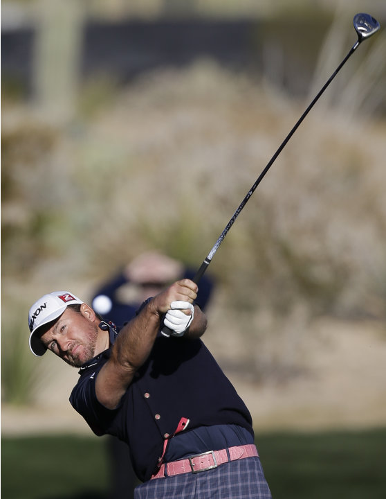 Graeme McDowell hits a shot off the first fairway during extra holes against Alexander Noren in the second round of play during the Match Play Championship golf tournament, Friday, Feb. 22, 2013, in M