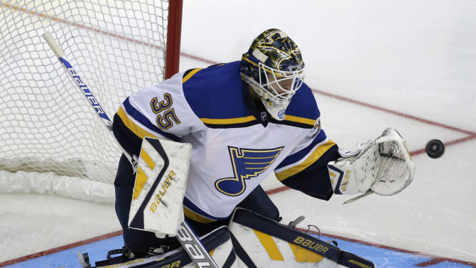 St. Louis Blues goalie Niklas Lundstrom (35) tries to stop a shot on goal during the third period of an NHL preseason hockey game against the Dallas Stars, Monday, Sept. 22, 2014, in Dallas. The Stars won 4-2. (AP Photo/LM Otero)
