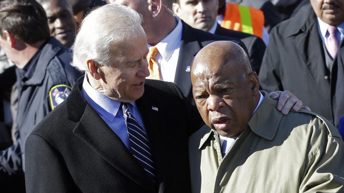 Vice President Joe Biden embraces U.S. Rep. John Lewis, D-Ga., as they prepare to lead a group across the Edmund Pettus Bridge in Selma, Ala., Sunday, March 3, 2013. They were commemorating the 48th anniversary of Bloody Sunday, when police officers beat marchers when they crossed the bridge on a march from Selma to Montgomery. (AP Photo/Dave Martin)