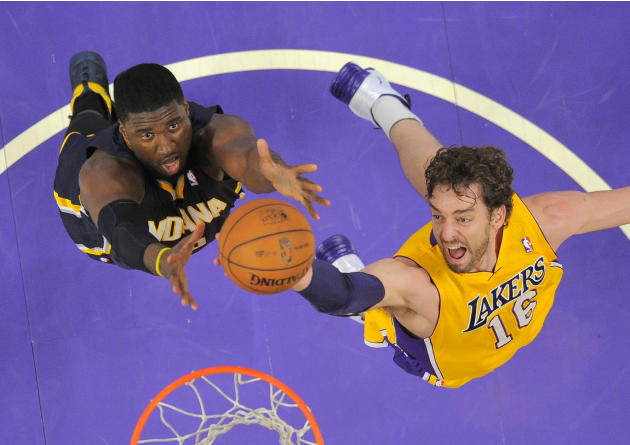 Los Angeles Lakers center Pau Gasol, right, of Spain, reaches for a rebound along with Indiana Pacers center Roy Hibbert during the first half of an NBA basketball game, Tuesday, Jan. 28, 2014, in Los