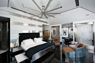 The third floor is comprised of a fully encapsulated 2,500-square-foot master suite, replete with a free-floating bed, office, master bath, dressing rooms, and balcony, that doubles as a panic room in the case of hurricane or other disaster.