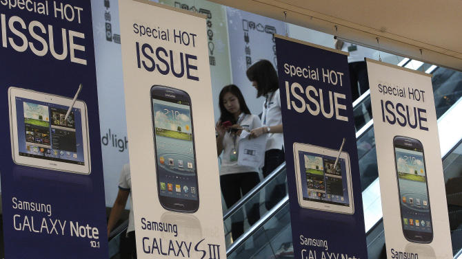 Banners advertising Samsung Electronics' Galaxy S III and Note 10.1 are displayed at the showroom of its headquarters in Seoul, South Korea, Friday, Aug. 24, 2012. The Seoul Central District Court ruled Friday that technology rivals Apple Inc. and Samsung Electronics Co. both infringed on each other's patents, and ordered a partial ban of their products in South Korea. Each side was also ordered to pay limited damages. (AP Photo/Ahn Young-joon)