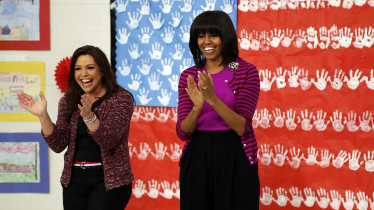 "First lady Michelle Obama and Food Network chef Rachel Ray greet students at a ""Let's Move!"" program at the Eastside and Northside Elementary Schools in Clinton, Miss., Wednesday, Feb. 27, 2013. Obama and Ray visited with the children and conducted a cooking contest between the schools chefs. (AP Photo/Rogelio V. Solis)"