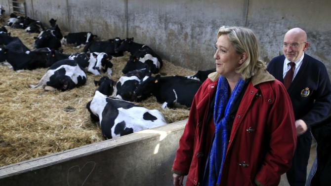 Marine Le Pen, French National Front political party leader and candidate for the National Front in the Nord-Pas-de-Calais-Picardie region, campaigns in a milk farm in Le Nouvion-en-Thierache