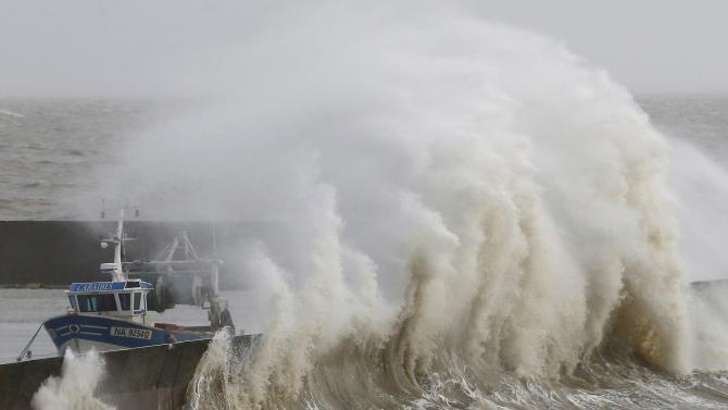 Waves crash on the protecting wall at the fishing harbour in Pornic as stormy weather with high winds hits the French Atlanitic coast
