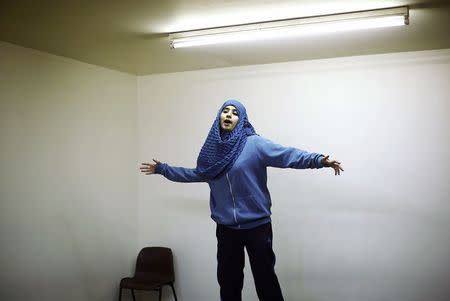 Youth worker Sumreen teaches children a nasheed or Islamic religious song, at a Islamic youth centre in Leyton, east London