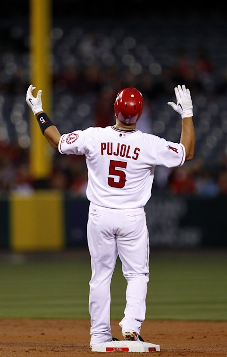 Los Angeles Angels' Albert Pujols celebrates after a double against the Minnesota Twins during a baseball game in Anaheim, Calif., Monday, April 30, 2012. Baseball's most feared slugger has suddenly l