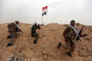 Iraqi Shiite fighters from the Popular Mobilization …