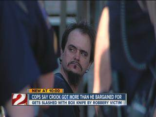 Robbery victim cuts suspect with box knife