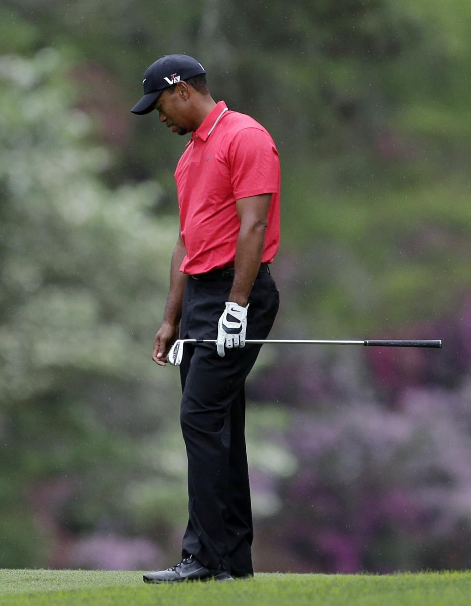 Tiger Woods reacts after his approach shot to the 14th hole during the fourth round of the Masters golf tournament Sunday, April 14, 2013, in Augusta, Ga. (AP Photo/Charlie Riedel)