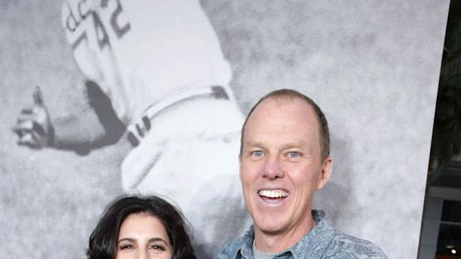 """Warner Bros.' Sue Kroll and Director and screenplay writer Brian Helgeland at The Los Angeles Premiere of Warner Bros. Pictures' and Legendary Pictures' """"42"""", on Tuesday, April, 9th, 2013 in Los Angeles. (Photo by Eric Charbonneau/Invision for Warner Bros./AP Images)"""