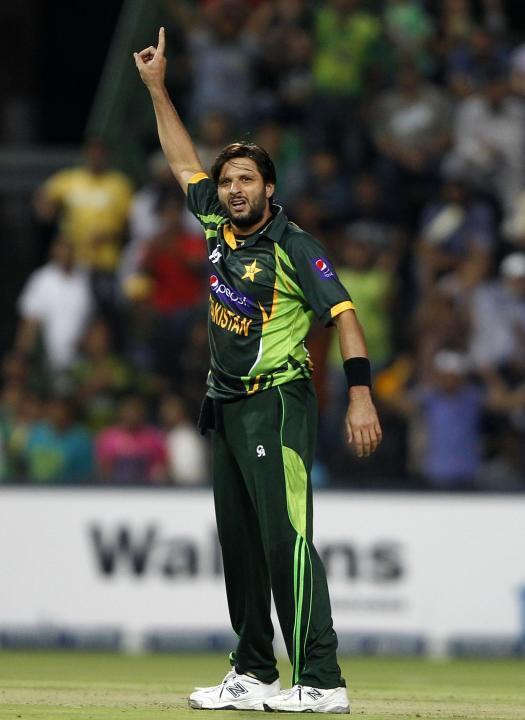 Pakistan's Shahid Afridi celebrates bowling out South Africa's Henry Davids during their first Twenty20 cricket match in Johannesburg