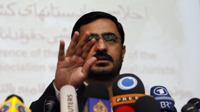In this Sunday, April 19, 2009 photo, former Tehran prosecutor Saeed Mortazavi, gestures, during a news conference, in Tehran, Iran. Mortazavi, a close ally of President Mahmoud Ahmadinejad, has been arrested, two years after a parliamentary probe found him responsible for deaths by torture of at least three jailed anti-government protesters, state media reported. (AP Photo/Vahid Salemi)