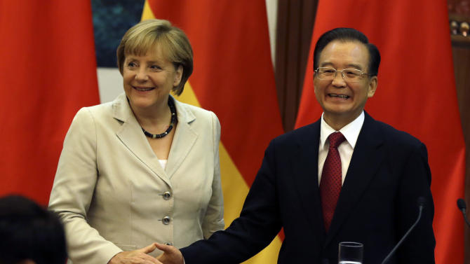 German Chancellor Angela Merkel, left, shakes hands with Chinese Premier Wen Jiabao after a joint press conference at the Great Hall of the People in Beijing, China, Thursday, Aug. 30, 2012. (AP Photo/Ng Han Guan)