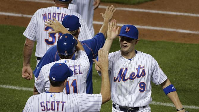New York Mets right fielder Brandon Nimmo (9) celebrates with teammates after the Mets defeated the Chicago Cubs 10-2 in a baseball game, early Saturday, July 2, 2016, in New York. (AP Photo/Julie Jacobson)